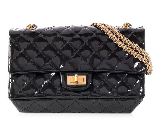 Preload https://img-static.tradesy.com/item/24549500/chanel-255-reissue-flap-puffy-quilted-marine-fonce-dark-blue-patent-leather-shoulder-bag-0-0-540-540.jpg