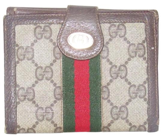 Preload https://img-static.tradesy.com/item/24550510/gucci-brown-large-g-logo-print-coated-canvas-and-brown-leather-with-a-red-and-green-center-stripe-vi-0-1-540-540.jpg