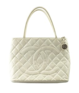 49f1f98554 Chanel Leather Gold-tone Adult Stretching Tote in Cream