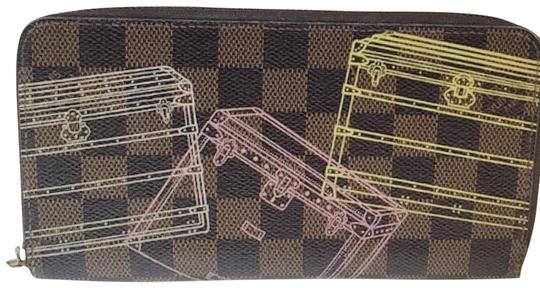 Preload https://img-static.tradesy.com/item/24555323/louis-vuitton-brown-limited-damier-ebene-coated-canvas-zippered-wallet-0-4-540-540.jpg