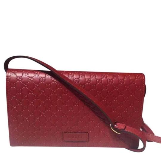 Preload https://img-static.tradesy.com/item/24555643/gucci-gg-signature-wallet-with-strap-red-leather-cross-body-bag-0-0-540-540.jpg