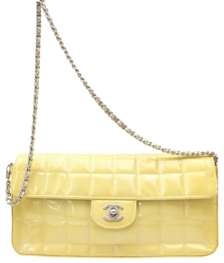 Preload https://img-static.tradesy.com/item/24555782/chanel-east-west-quilted-chocolate-bar-flap-869289-yellow-patent-leather-shoulder-bag-0-1-540-540.jpg
