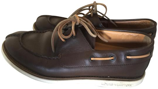 Preload https://img-static.tradesy.com/item/24556323/louis-vuitton-brown-loafers-italy-flats-size-eu-365-approx-us-65-regular-m-b-0-1-540-540.jpg