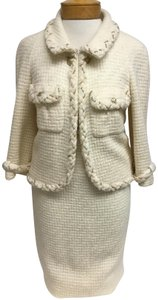 Chanel Cream tweed skirt suit with gold chain trim