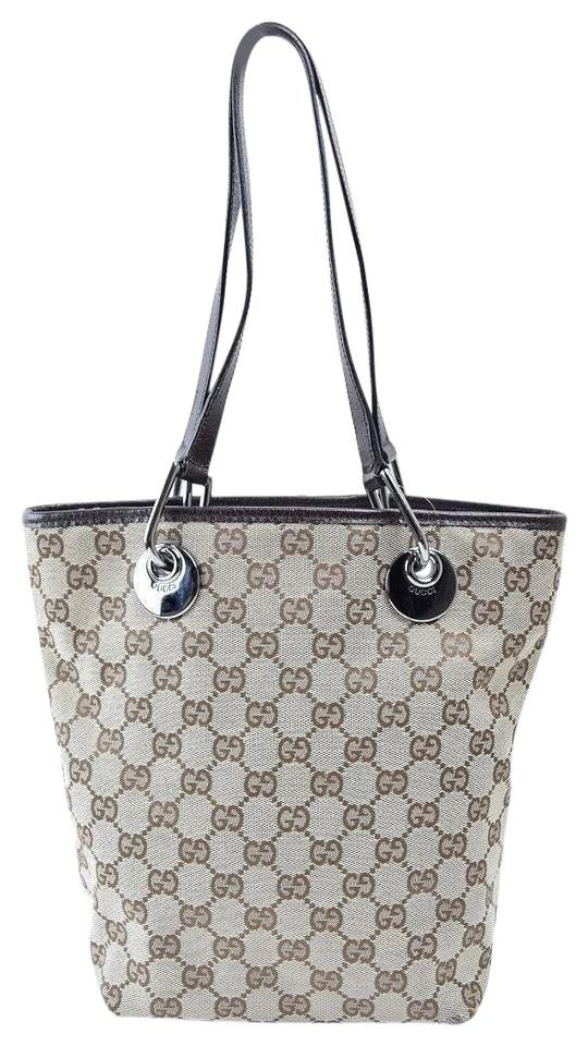 bb0bf6338007 Gucci Bold Chrome Accents Mint Condition Graduated Shape Canvas/Leather Tote  in brown large G ...