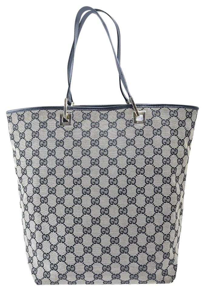 facdf03115c4 Gucci Mint Condition Graduated Shape Bold Gold Accents Canvas/Leather Tote  in navy blue large ...