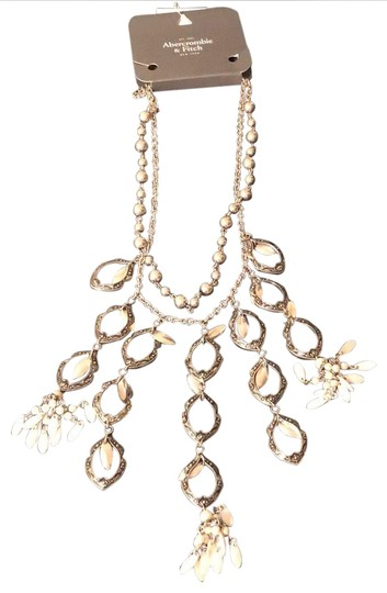 Preload https://img-static.tradesy.com/item/24572190/abercrombie-and-fitch-silver-and-white-na-necklace-0-1-540-540.jpg