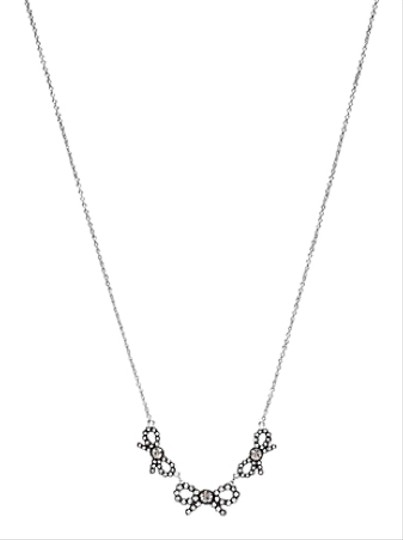 Preload https://img-static.tradesy.com/item/24572517/coach-silver-triple-stone-bow-necklace-0-1-540-540.jpg