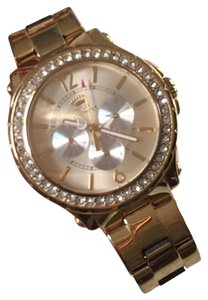 Juicy Couture gold tone watch