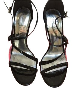 Ivanka Trump Black patent leather with transparent inset at toe strap. Sandals