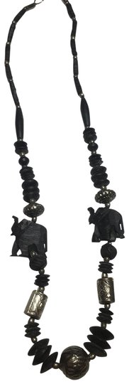 Preload https://img-static.tradesy.com/item/24588058/black-and-silver-elephant-wood-beaded-necklace-0-1-540-540.jpg
