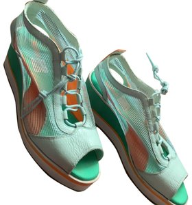 fd8d1b464400 Puma teal green leather and mesh fabric and laces. white wedge platform  heel and orange
