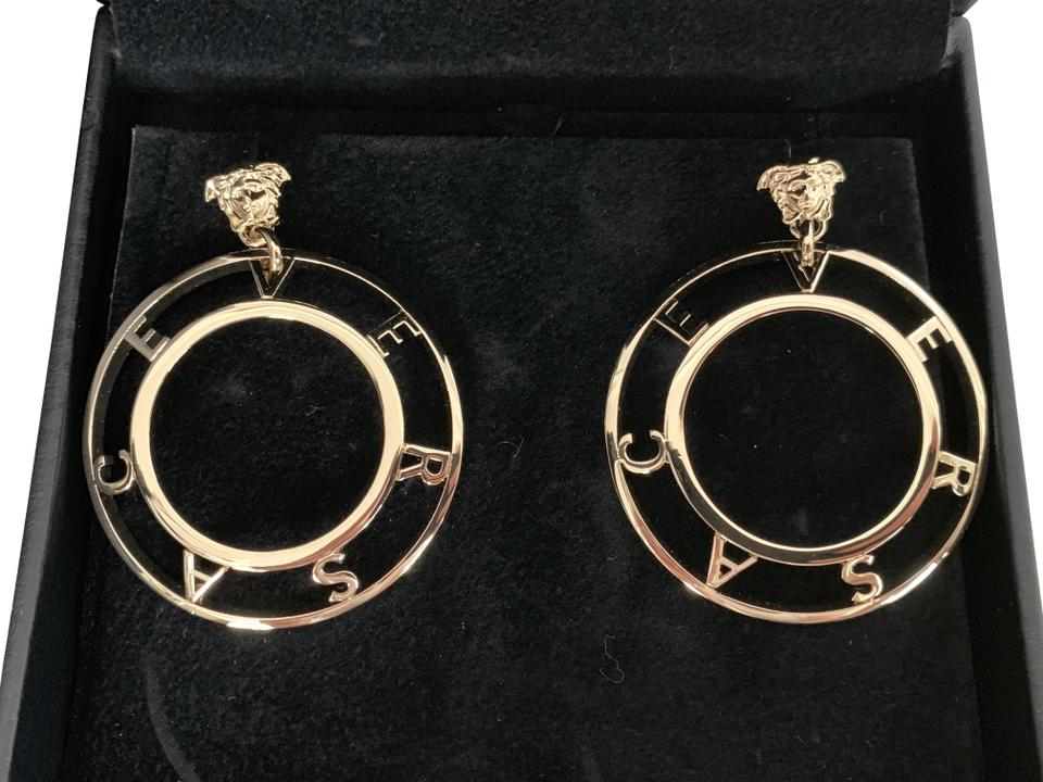 415638c66 Versace Medusa Letter Logo Gold Tone Large Round Cut Out Drop Hoop Earrings  Image 0 ...