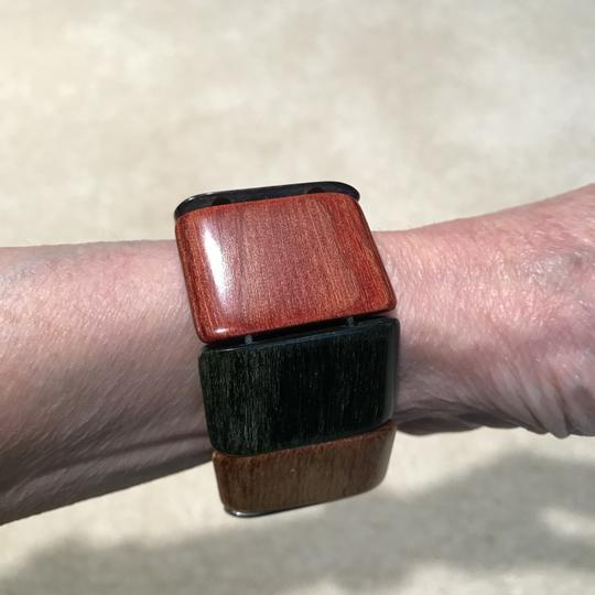 Other Smooth Wood Bracelet in Red, Gold, Brown, Green