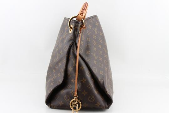Louis Vuitton Black Leather Tote in Brown Image 1