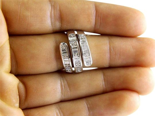 Preload https://img-static.tradesy.com/item/24599809/white-emerald-and-round-cluster-diamond-bypass-band-18k-gold-154ct-ring-0-2-540-540.jpg