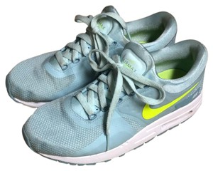 Nike baby blue with neon yellow swoosh Athletic