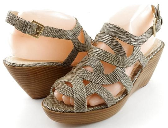 Preload https://img-static.tradesy.com/item/24606745/rebecca-minkoff-washed-lizard-interlock-leather-open-strappy-wedges-85-sandals-size-us-75-regular-m-0-1-540-540.jpg