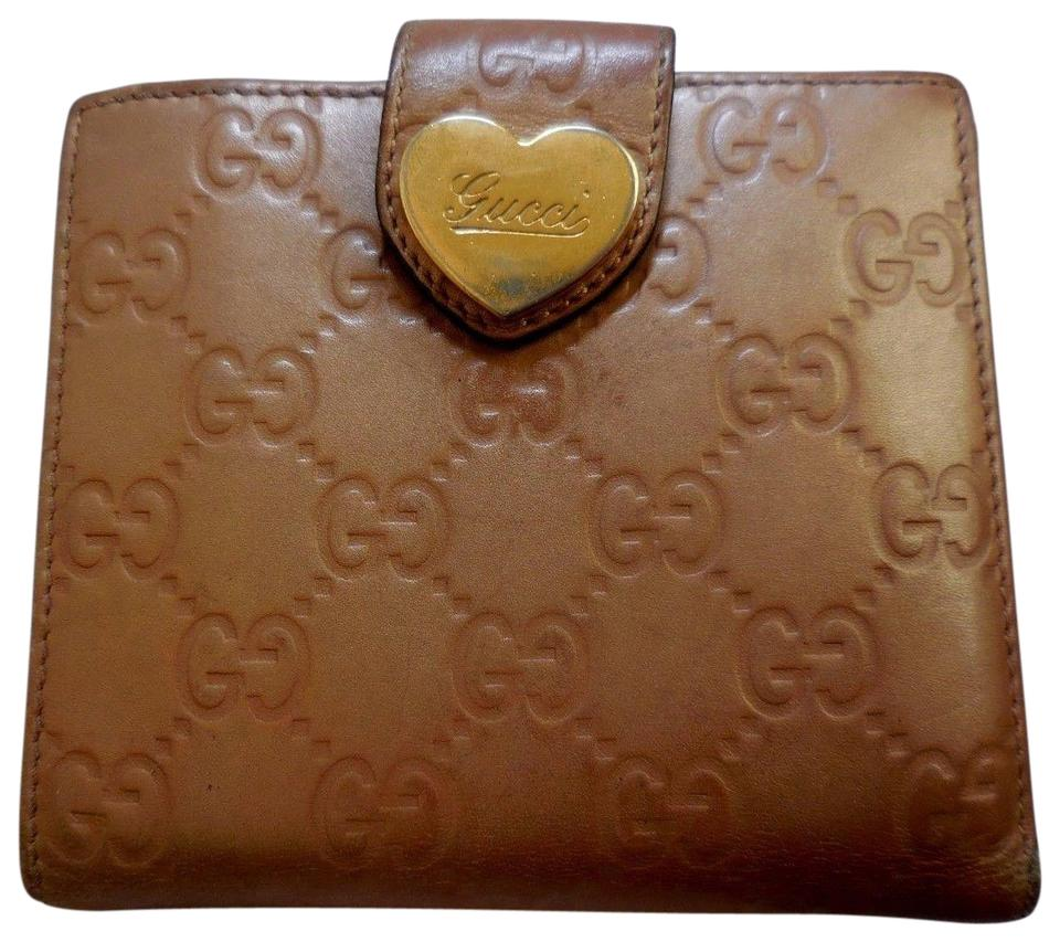 1a3a166ac718 Gucci Gucci embossed large G design leather wallets with gold heart accent  Image 0 ...