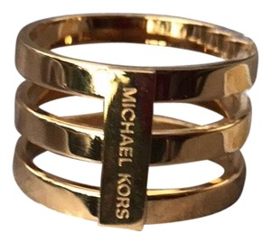 Michael Kors MIchael kors gold tone ring size 9 with pouch. Comes with original MK pouch and booklet.