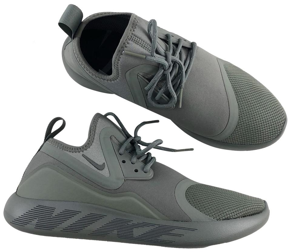02b65056df2c Nike Green Women s Lunarcharge Essential Sneakers Features A ...