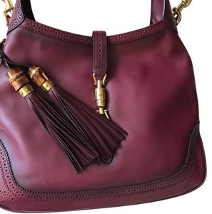 a1417a655f7 Gucci Canvas Lined Brass Clasp Hobo Bag · Gucci. Jackie Maroon Leather ...