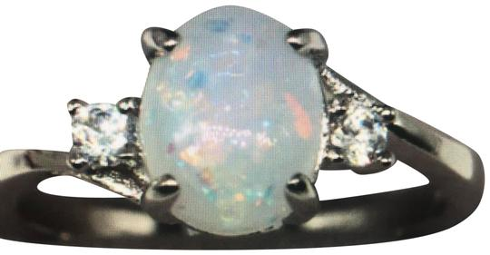 Preload https://img-static.tradesy.com/item/24617987/white-silver-fire-opal-oval-diamond-925-cocktail-engagement-wedding-bridal-ring-0-1-540-540.jpg