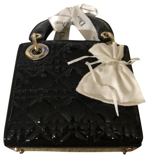 Preload https://img-static.tradesy.com/item/24618237/dior-lady-dior-christian-in-patent-and-light-gold-hardware-black-calfskin-leather-satchel-0-2-540-540.jpg