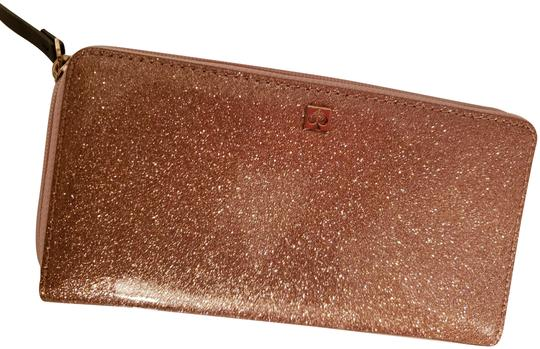 Preload https://img-static.tradesy.com/item/24622460/kate-spade-rose-gold-glitter-new-with-tags-needa-wallet-0-1-540-540.jpg