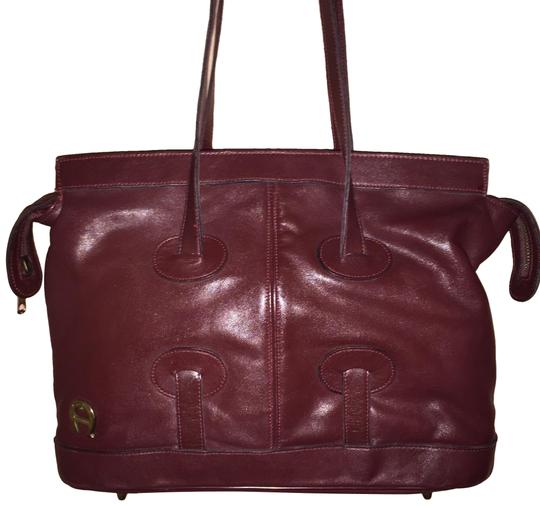 Preload https://img-static.tradesy.com/item/24623795/etienne-aigner-vintage-burgundy-leather-tote-0-2-540-540.jpg