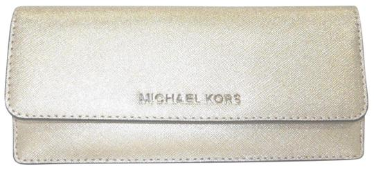 Preload https://img-static.tradesy.com/item/24624434/michael-kors-flat-jet-set-travel-saffiano-wallet-pale-gold-leather-wristlet-0-1-540-540.jpg