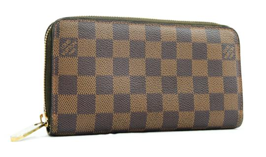 Preload https://img-static.tradesy.com/item/24624571/louis-vuitton-brown-damier-ebene-zippy-lv-n60015-lv-wallet-0-0-540-540.jpg