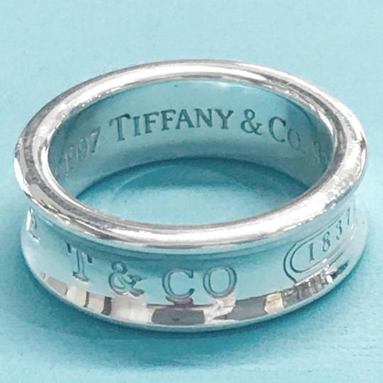 Tiffany & Co. ICONIC!! Tiffany & Co. Sterling Silver 1837 Ring Sterling Silver Size 5 100% Authentic Guaranteed!! Comes with Tiffany Blue Colored Polishing Cloth!!