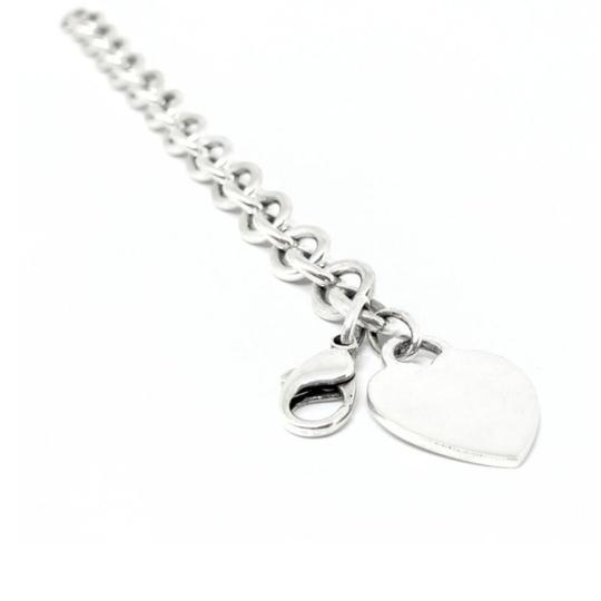 Preload https://img-static.tradesy.com/item/24624876/tiffany-and-co-sensational-heart-tag-sterling-silver-75-guaranteed-comes-with-polishing-cloth-and-po-0-6-540-540.jpg