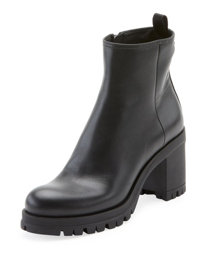 Preload https://img-static.tradesy.com/item/24625418/prada-black-leather-lug-sole-platform-with-logo-bootsbooties-size-us-85-regular-m-b-0-0-540-540.jpg