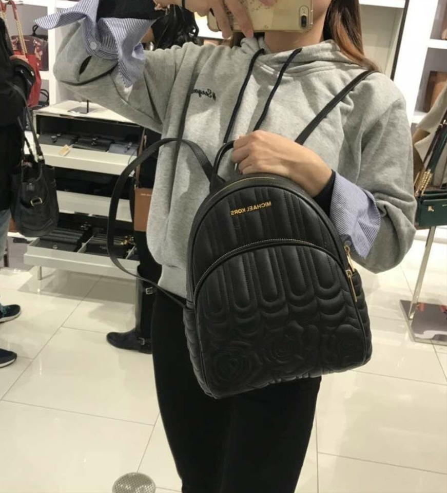 e7996d135abf Michael Kors Abbey Medium Quilted Floral Black Leather Backpack ...