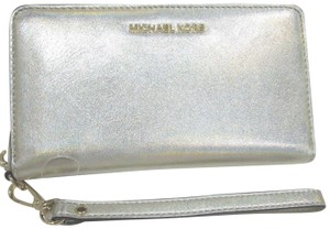 0f0c9eb1aded Michael Kors Leather Wallet 191935096081 Wristlet in Pale Gold