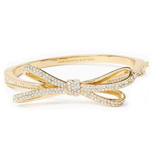 Preload https://img-static.tradesy.com/item/24632399/kate-spade-cleargold-tied-up-pave-bow-bangle-cleargold-bracelet-0-0-540-540.jpg