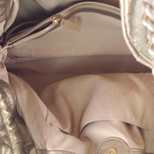 Chanel Tote in Gold Image 11
