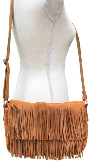 Preload https://img-static.tradesy.com/item/24633079/street-level-fringe-brown-suede-cross-body-bag-0-3-540-540.jpg