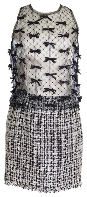 Preload https://img-static.tradesy.com/item/24633169/chanel-fantasy-white-black-silk-tweed-lace-bows-top-two-pieces-mid-length-cocktail-dress-size-12-l-0-2-650-650.jpg