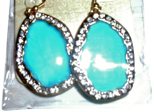 Preload https://img-static.tradesy.com/item/24634847/several-colors-flat-shell-oval-surrounded-by-rhinestone-diamonds-earrings-0-1-540-540.jpg