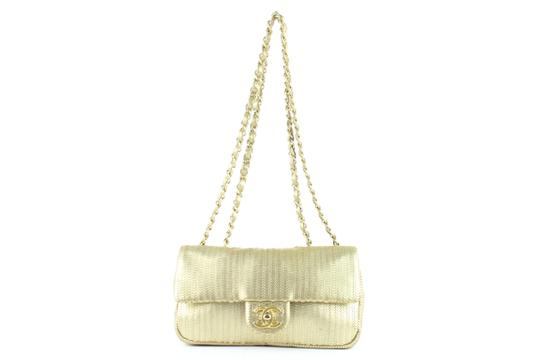 Preload https://img-static.tradesy.com/item/24635226/chanel-laser-cut-small-classic-chain-flap-13ce0104-gold-leather-cross-body-bag-0-0-540-540.jpg