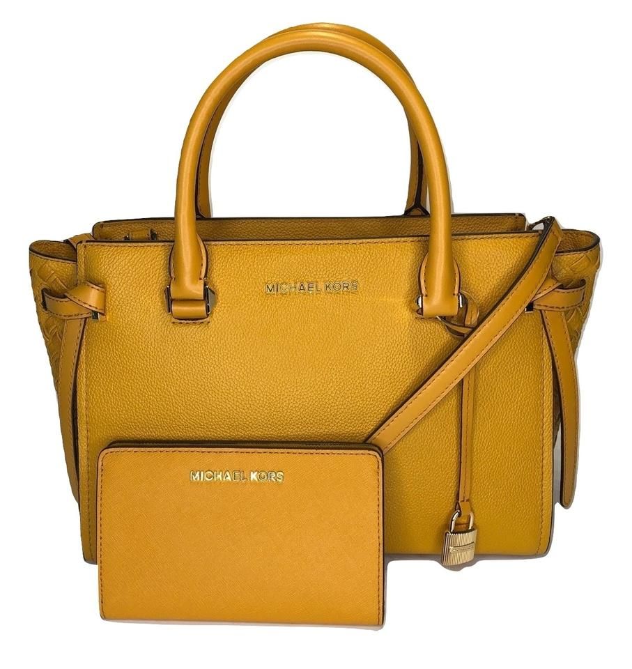 53eab8e50762 Michael Kors Selma Md Mk Cassie Md Yellow Slim Bifold Wallet Satchel in  Marigold Image 0 ...