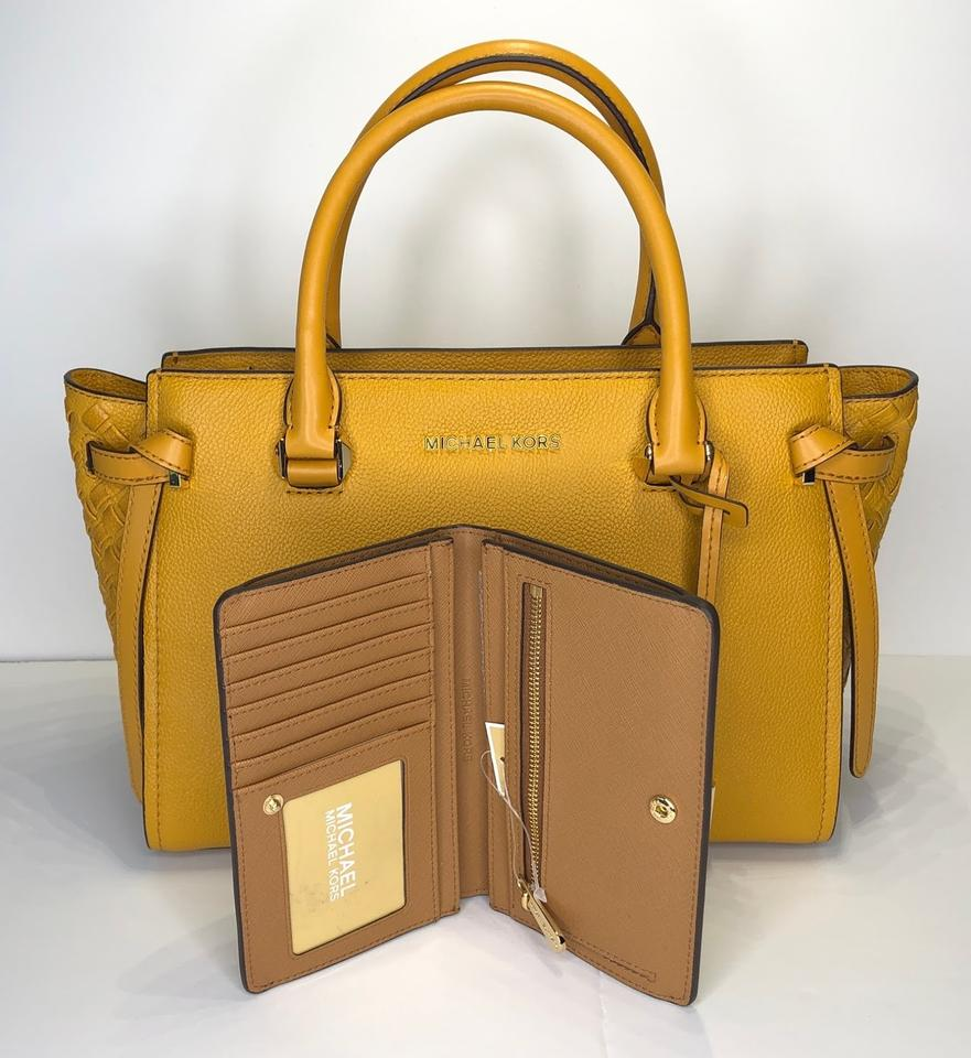 44eed4e0fcc6 Michael Kors Selma Md Cassie Md Yellow Slim Bifold Wallet Satchel in  Marigold Signature MK. 123456789101112
