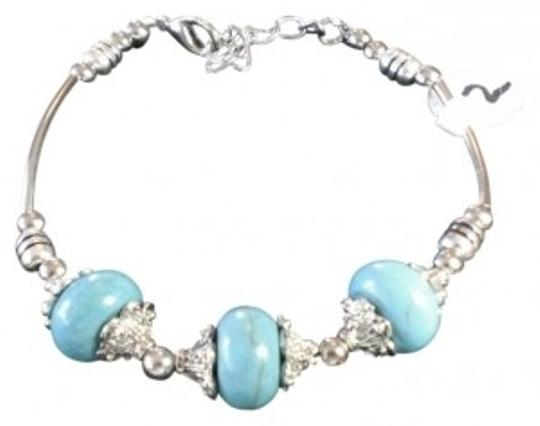 Preload https://item4.tradesy.com/images/turquoise-with-s-steel-bracelet-24638-0-0.jpg?width=440&height=440