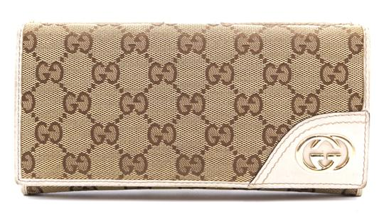 Preload https://img-static.tradesy.com/item/24638128/gucci-26242-beige-off-white-cream-gg-logo-canvas-and-leather-flap-long-double-compact-wallet-0-1-540-540.jpg