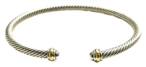 "David Yurman GORGEOUS!! LIKE NEW!! David Yurman 18 Karat Yellow Gold and Sterling Silver Cable Classic 4mm Bracelet Cuff 18 Karat Yellow Gold Sterling Silver 4mm Size: 7.25"" Flexible sizing 100% Authentic Guaranteed!! Comes with Original David Yurman Pouch!!!"