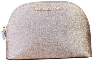 cf82e36757f949 Michael Kors Clutches - Up to 90% off at Tradesy