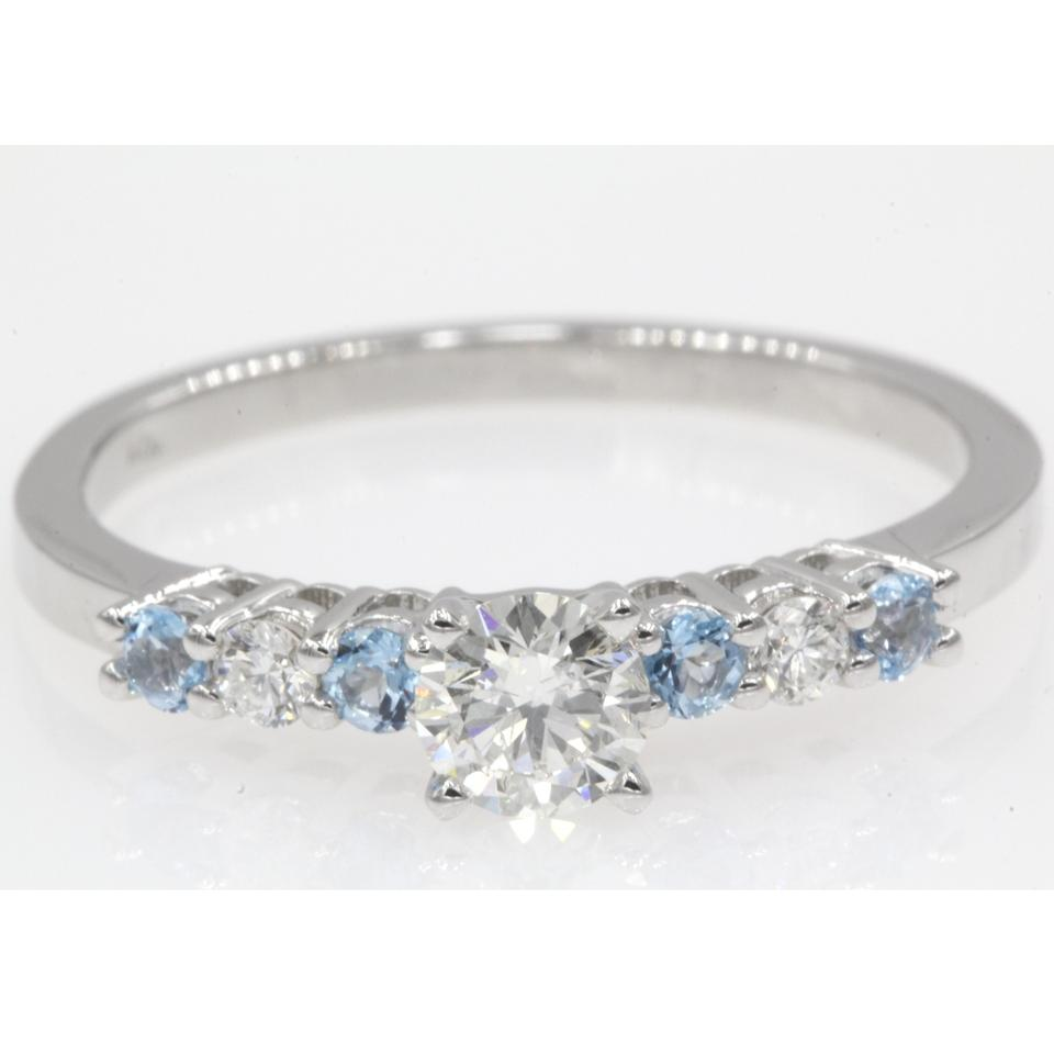 6d80a8f14a1b20 14k White Gold .94 Carat Round Cut with Ice Blue Topaz Engagement Ring